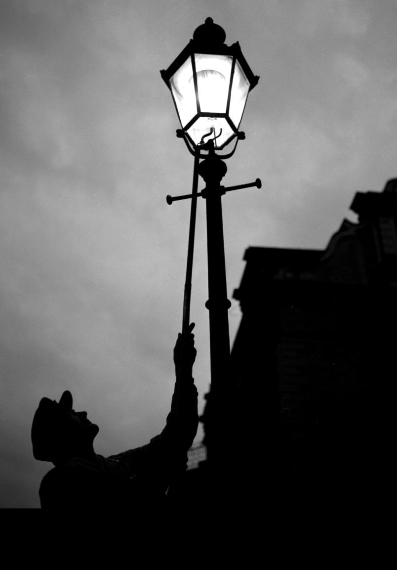 Lamplighter at dusk